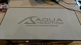 AquaTraction Pad light gray on black with laser etching